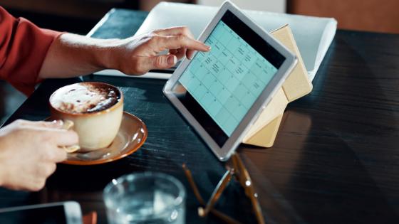 Calendar on tablet; coffee shop