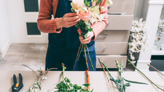 Small Business Owner - Florist, woman arranging bouquet of flowers